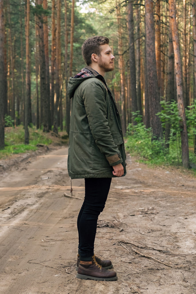 Side View Of Traveler On Road In Forest