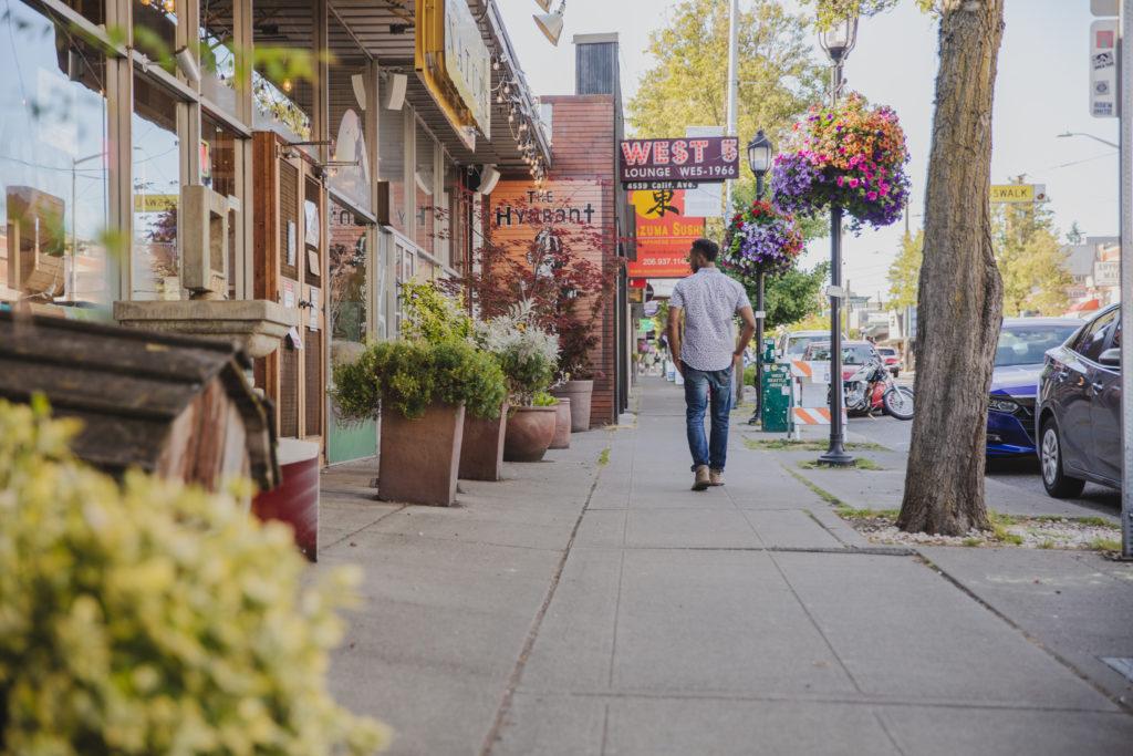 Maris Seattle person walking down the neighborhood street