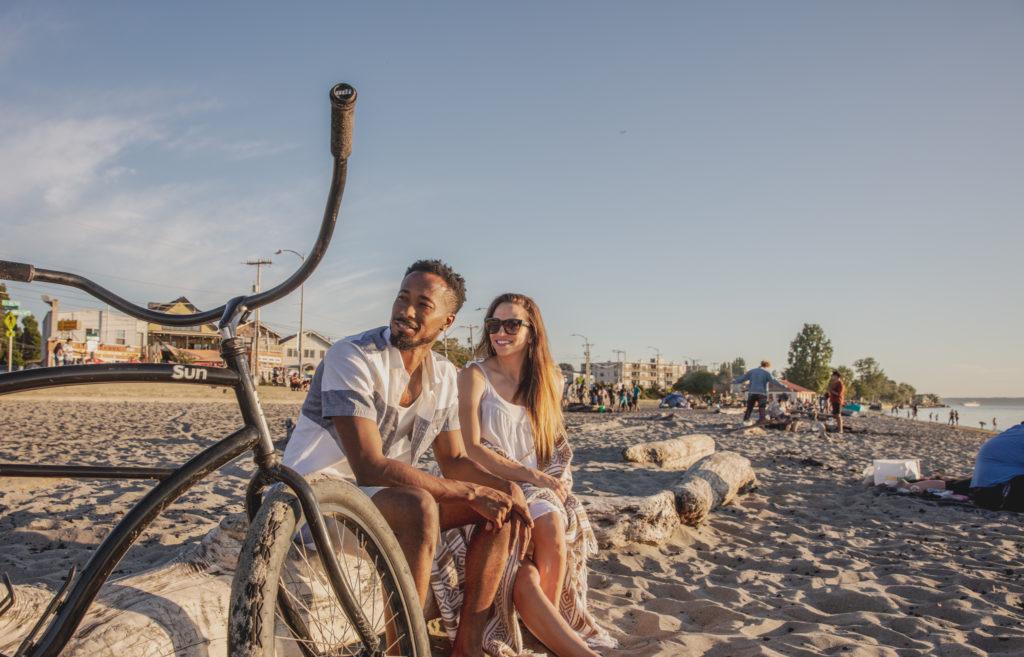 Maris Seattle couple sitting on a beach