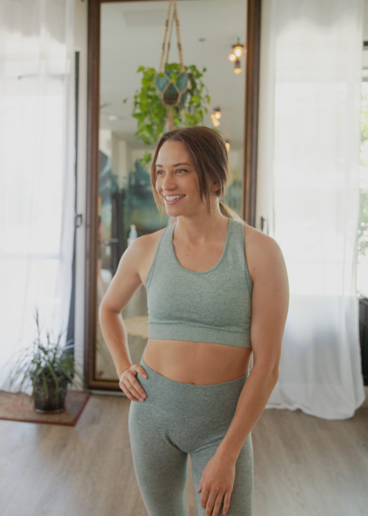 Maris Seattle person in yoga outfit inside yoga studio